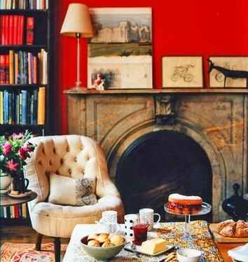 armchair, books, decor and fireplace