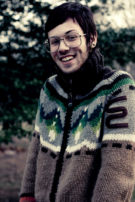 bokeh, boy, cheek piercings, cute, fashion, glasses, guy, hipster, hipster boy, hipster kid, indie, indie kid, jersey, jumper, knitted jersey, knitted sweater, knitwear, nature, photography, pierced, piercings, smile, style, sweater, vintage