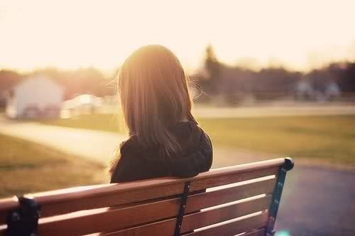 Girl Sitting Alone On Bench Image