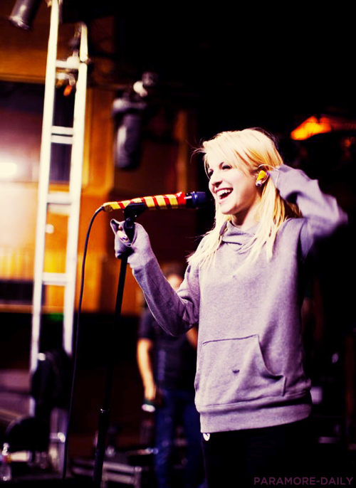 blonde, hair, hayley, hayley williams, laugh, microphone, music, paramore, picture, purple, smile, sweatshirt, yellow